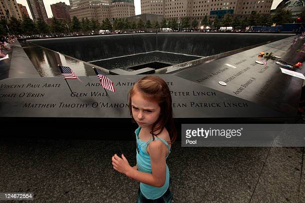 Keri McMorrow visits the memorial pool where her uncle's name is engraved during tenth anniversary ceremonies of the September 11 2001 terrorist...