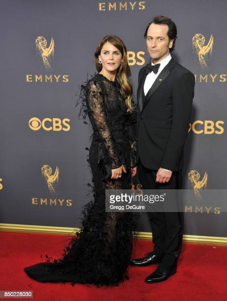 Keri Russell and Matthew Rhys arrive at the 69th Annual Primetime Emmy Awards at Microsoft Theater on September 17 2017 in Los Angeles California