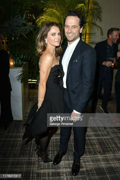 Keri Russell and Matthew Rhys attend The Hollywood Foreign Press Association and The Hollywood Reporter party at the 2019 Toronto International Film...