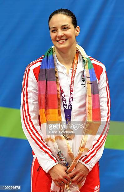 KeriAnn Payne of England poses with the bronze medal during the medal ceremony for the Women's 400m Individual Medely Final at Dr SP Mukherjee...