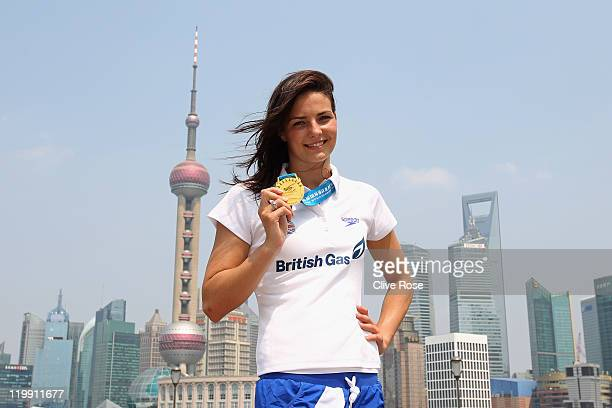 KeriAnne Payne of Great Britain poses by the Bund river with her Gold medal that she won during the Womens Open Water 10k event during Day Twelve of...
