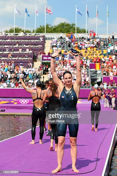 KeriAnne Payne of Great Britain waves to the crowd after finishing fourth in the Women's Marathon 10km Swimming at Hyde Park on August 9 2012 in...