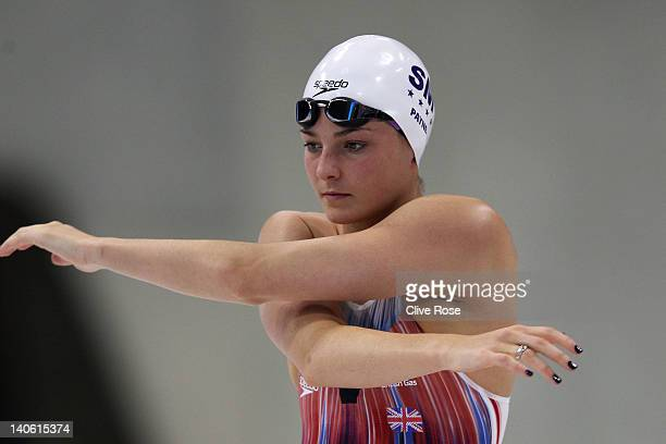 KeriAnne Payne of Stockport stretches prior to the Women's Open 400m Individual Medley heat 5 during day one of the British Gas Swimming...