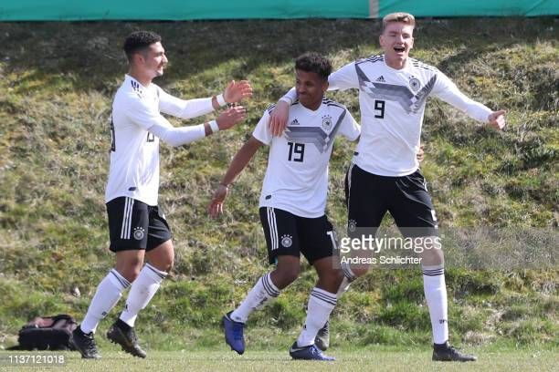Kerim Calhanoglu Karim Adeyemi and Nick Woltemade of Germany U17 celebrate during the UEFA Elite Round game between Germany U17 and Belarus U17 on...