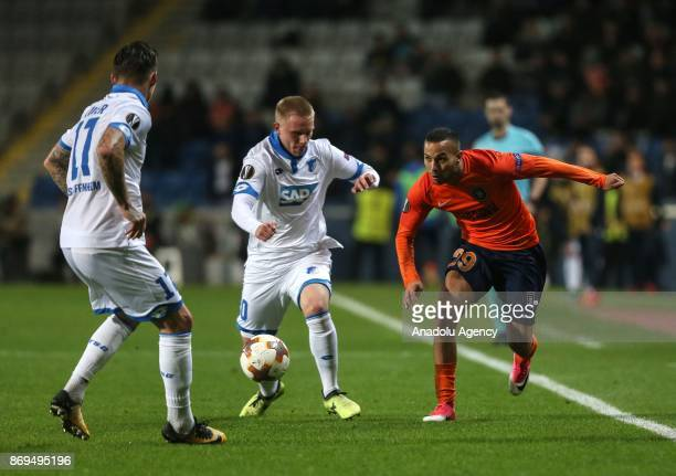 Kerim Frei of Medipol Basaksehir in action against Philipp Ochs and Steven Zuber of Hoffenheim during the UEFA Europa League Group C soccer match...