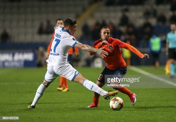 Kerim Frei of Medipol Basaksehir in action against Steven Zuber of Hoffenheim during the UEFA Europa League Group C soccer match between Medipol...