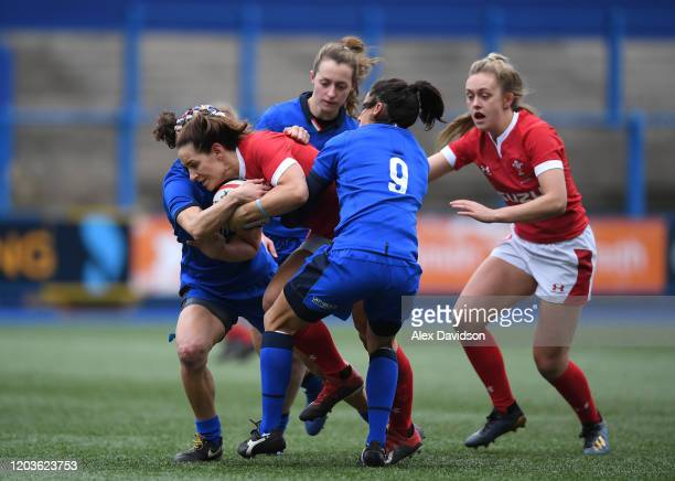 Kerin Lake of Wales is tackled by Sara Barattin of Italy during the 2020 Women's Six Nations match between Wales and Italy at Cardiff Arms Park on...