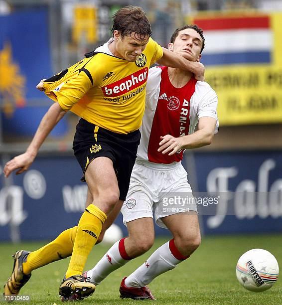 Kerkrade, NETHERLANDS: Roda JC player Andres Oper vies with Thomas Vermaelen of Ajax Amsterdam 17 September 2006 in the Parkstad Stade in Kerkrade....