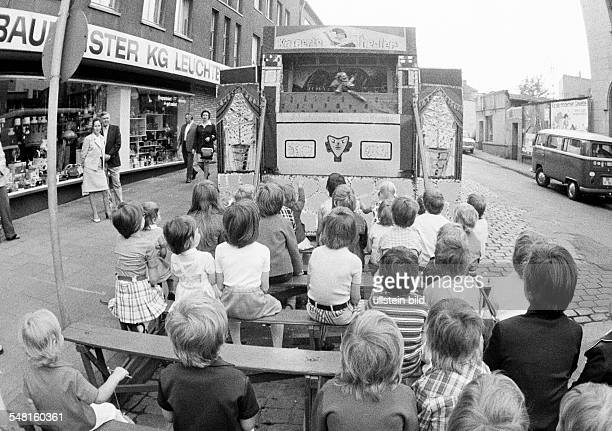 kermess people children sitting in a PunchandJudy show aged 4 to 8 years Corpus Christi Kermess 1973 DOberhausen DOberhausenSterkrade Ruhr area North...