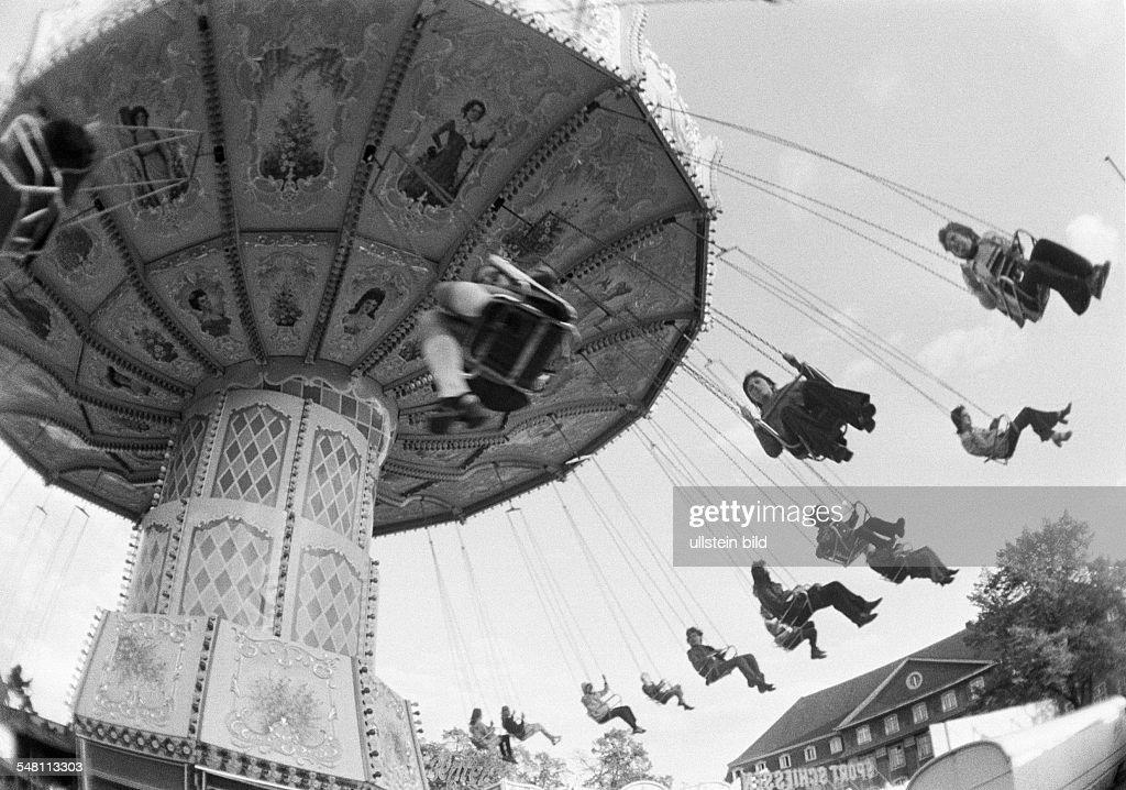 kermess, people on a chairoplane - 30.09.1973 : News Photo