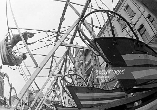 kermess people teenagers in a swingboat Corpus Christi Kermess 1973 DOberhausen DOberhausenSterkrade Ruhr area North RhineWestphalia