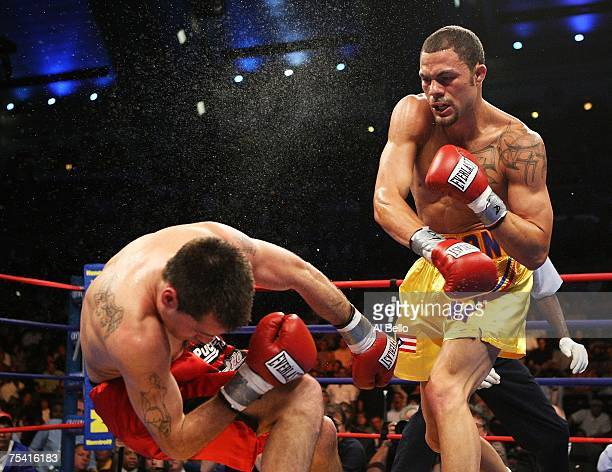 Kermit Cintron knocks out Walter Mathysse in the second round during their IBF Welterweight Championship fight on July 14 2007 at Boardwalk Hall in...