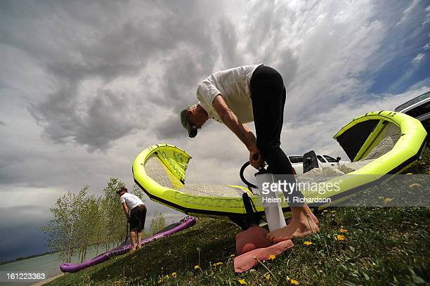 Kermit Lohry of Boulder pumps air into his kite that he will be kite surfing with on the reservoir He has been kite surfing for 12 years Boulder...