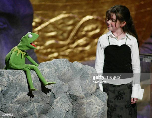 Kermit the Frog and Karle Warren speak on stage during the 17th Annual Genesis Awards at the Beverly Hilton Hotel on March 15 2003 in Beverly Hills...