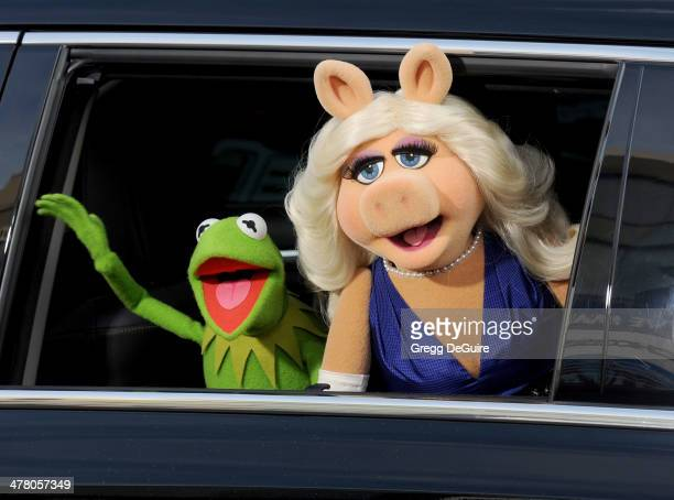 Kermit the Frog and Miss Piggy arrive at the Los Angeles premiere of Muppets Most Wanted at the El Capitan Theatre on March 11 2014 in Hollywood...