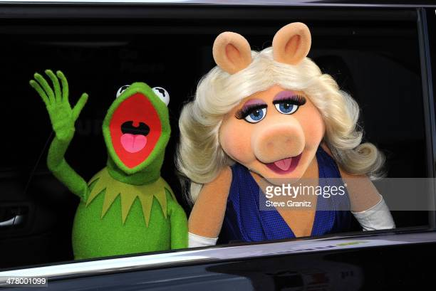 Kermit the Frog and Miss Piggy arrives at the Disney's 'Muppets Most Wanted' Los Angeles Premiere at the El Capitan Theatre on March 11 2014 in...