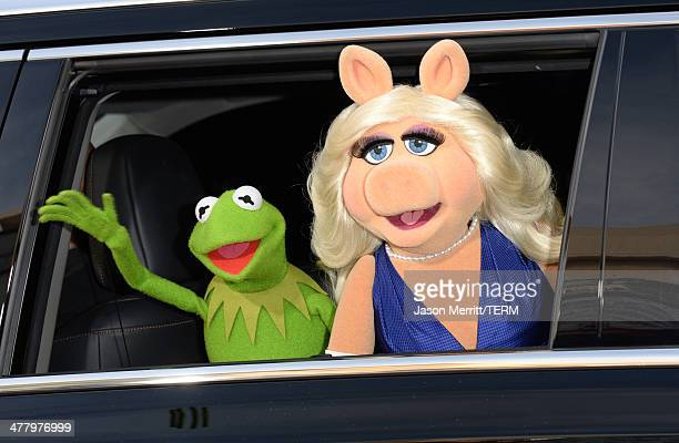 Kermit the Frog and Miss Piggy attend the premiere of Disney's Muppets Most Wanted at the El Capitan Theatre on March 11 2014 in Hollywood California