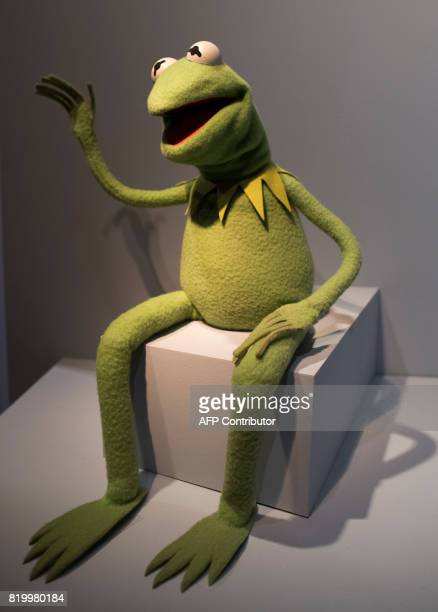 Kermit the Frog waves from his position at The Jim Henson Exhibition July 18 2017 at the Museum of the Moving Image in New York New York City is...