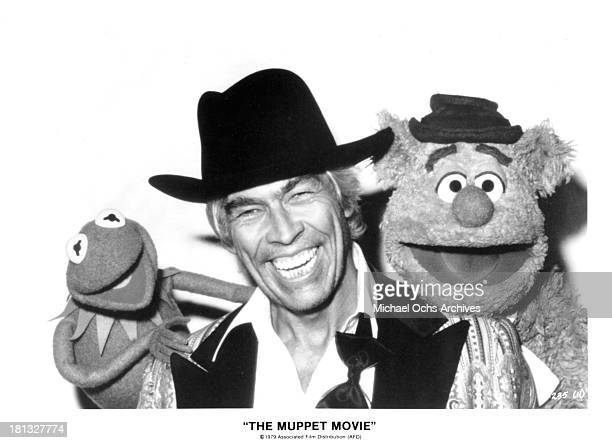 Kermit the Frog/Jim Henson actor James Coburn and Fozzie Bear/Frank Oz on set of The Muppet Movie in 1979