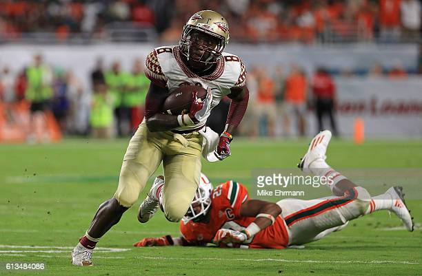 Kermit Whitfield of the Florida State Seminoles riushes for a touchdown during a game against the Miami Hurricanes at Hard Rock Stadium on October 8...