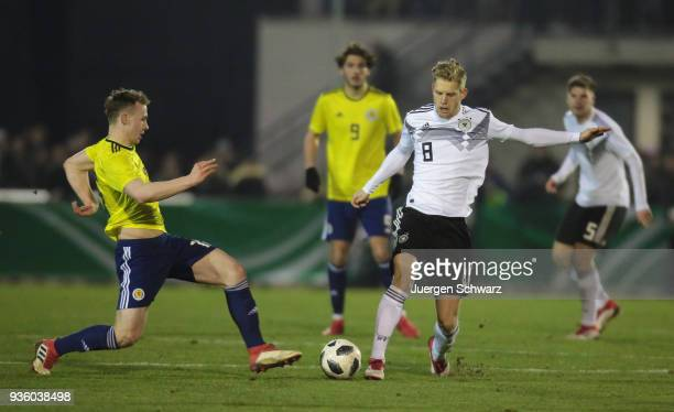 Kerr McInroy of Scotland tackles Arne Maier of Germany during the Under 19 Euro Qualifier between Germany and Scotland on March 21 2018 in Lippstadt...