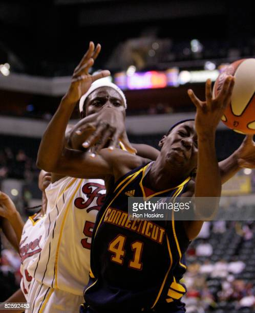 Kerri Gardin of the Connecticut Sun battles Bernadette Ngoyisa of the Indiana Fever at Conseco Fieldhouse on August 28 2008 in Indianapolis Indiana...