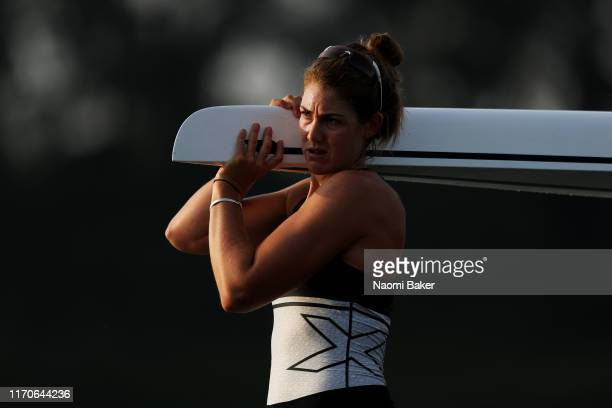 Kerri Gowler of New Zealand carries her boat off the water during Day Four of the 2019 World Rowing Championships on August 28 2019 in LinzOttensheim...
