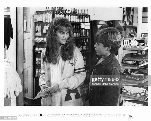 Kerri Green And Sean Astin talk in store in a scene from the film 'Goonies' 1985