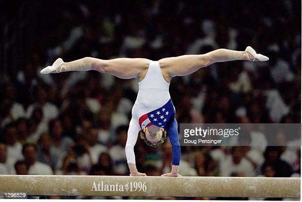 Kerri Strug of the United States stands on her hands and does the splits while competing in the balance beam part of the Womens Team Gymnastics...