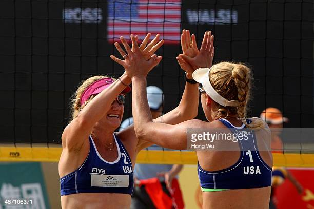 Kerri Walsh and April Ross of USA celebrate won women's final on Day 6 of the 2014 FIVB Beach Volleyball Fuzhou Open on April 27 2014 in Fuzhou China