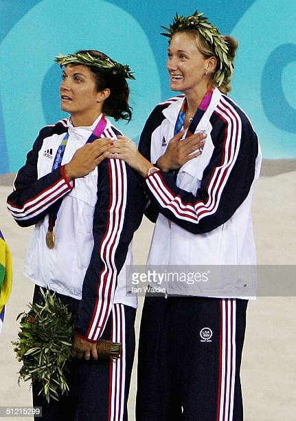 Kerri Walsh and Misty May of United States celebrate as they receive their gold medals during the women's Beach Volleyball medal ceremony on August...