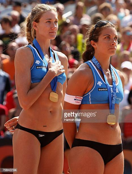 Kerri Walsh and Misty MayTreanor of USA listen to their national anthem with their gold medals after the Women's Final between Kerri Walsh and Misty...