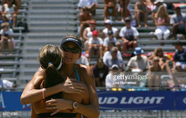 Kerri Walsh and teammate Misty May-Treanor celebrate their quarterfinal match victory during the AVP Hermosa Beach Open at the Hermosa Beach Pier on...