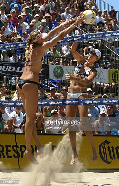 Kerri Walsh blocks a hit from Elaine Youngs during the AVP Manhattan Beach Open final match on August 12 2006 in Manhattan Beach California Misty...
