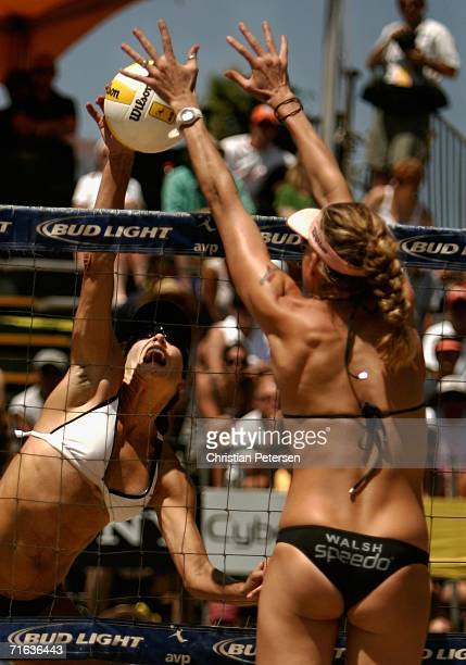 Kerri Walsh blocks a hit from Nancy Mason during the AVP Manhattan Beach Open final match on August 12 2006 in Manhattan Beach California Misty...