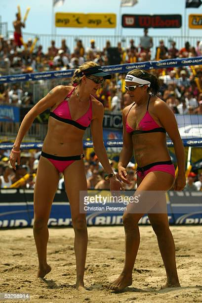 Kerri Walsh celebrates with Misty May-Treanor during the AVP Hermosa Beach Open at the Hermosa Beach Pier on July 24, 2005 in Hermosa Beach,...