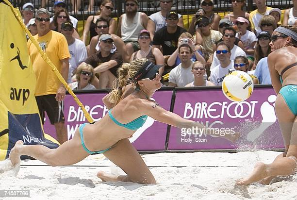 Kerri Walsh digs the ball while partner Misty MayTreanor watches during the women's semifinals against Annett Davis and Jenny Johnson Jordan in the...