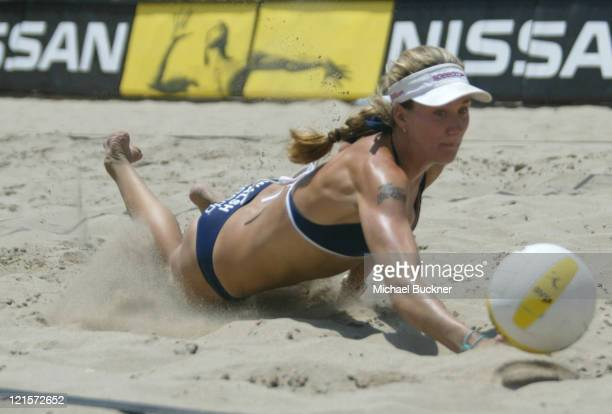 Kerri Walsh dives for the ball during the semifinal match against Annett Davis and Jenny Johnson Jordan Riding an 88 game winning streak Walsh and...