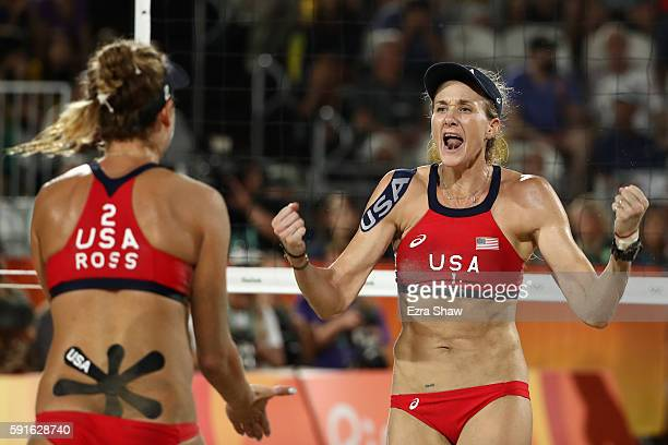 Kerri Walsh Jennings and April Ross of the United States celebrate a point during the Beach Volleyball Women's Bronze medal match against Larissa...
