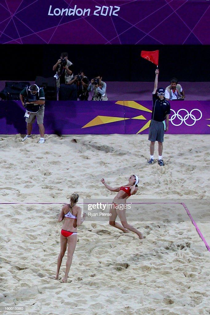 Kerri Walsh Jennings (L) and Misty May-Treanor of the United States celebrate winning the Gold medal in the Women's Beach Volleyball Gold medal match against the United States on Day 12 of the London 2012 Olympic Games at the Horse Guard's Parade on August 8, 2012 in London, England.