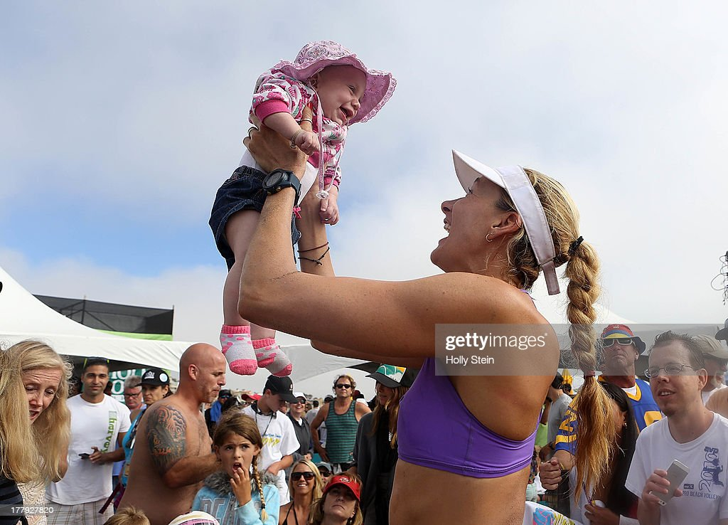 Kerri Walsh Jennings holds up her daughter Scout after winning the women's finals at the AVP Manhattan Beach Open on August 25, 2013 in Manhattan Beach, California. Jennings and her partner Whitney Pavlik defeated Brooke Sweat and Jennifer Fopma 22-20, 21-17.
