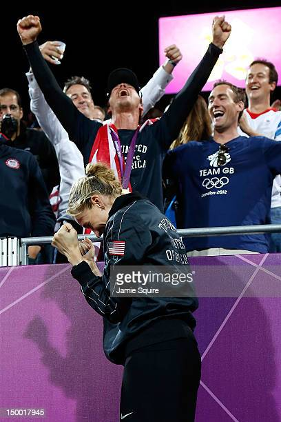 Kerri Walsh Jennings' husband Casey Jennings wears her Gold medal as they celebrate winning the Gold medal for the Women's Beach Volleyball on Day 12...