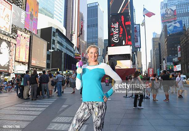 Kerri Walsh Jennings in the heart of Times Square poses with her most recent gold medal as she looks ahead to 2016 and debuts her new 'Kerri' apparel...