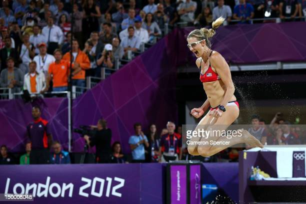 Kerri Walsh Jennings of the United States celebrates winning the Gold medal in the Women's Beach Volleyball Gold medal match against the United...