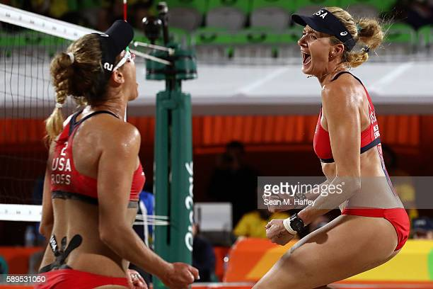 Kerri Walsh Jennings of United States celebrates with teammate April Ross after defeating Australia in a Women's Quarterfinal match on Day 9 of the...