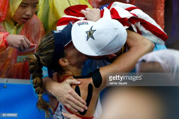 Kerri Walsh of the United States kisses her husband Casey Jennings after she won the gold medal with her partner Misty MayTreanor during the women's...