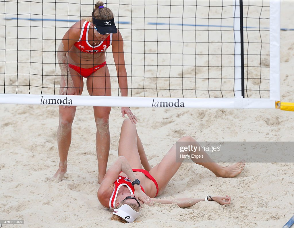 Kerri Walsh of the USA (R) lies on the floor after injuring her shoulder diving for the ball as teammate April Ross looks on during Day 2 of the FIVB Moscow Grand Slam on May 27, 2015 in Moscow, Russia.