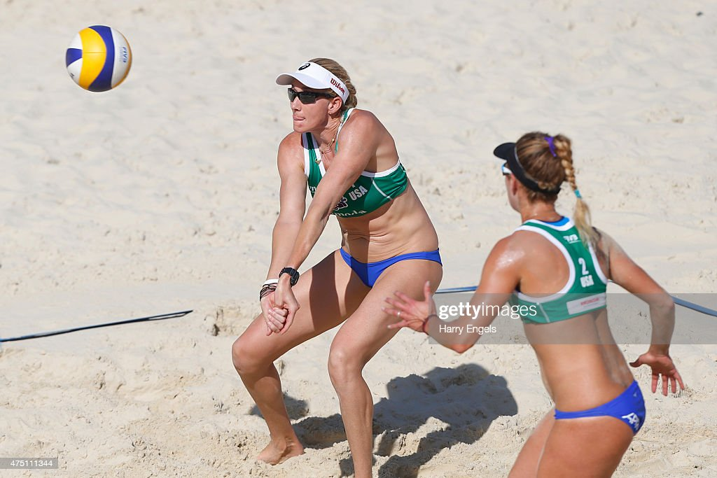 Kerri Walsh of the USA (L) returns a serve as teammate April Ross looks on during Day 2 of the FIVB Moscow Grand Slam on May 27, 2015 in Moscow, Russia.