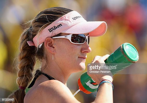 Kerri Walsh of USA sprays herself with water before the gold medal match against Brazil in the AVP Crocs Tour World Challenge at the Westgate City...