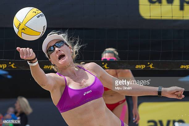 Kerri WalshJennings dives to recover a ball as April Ross looks on at the AVP New Orleans Open at Laketown on May 24 2015 in Kenner Louisiana